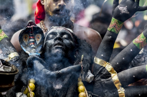 Black Kaali by Elangovan Subramanian. Dussehra is a Hindu Annual Celebration.Here,in kulasekarapattinam,Tamilnadu,India it is being celebrated by thousnads of devottees who offer prayer to the god by disguising themselves as one of their gods,pray at the temple and remove their makeups at the sea shore nearby.