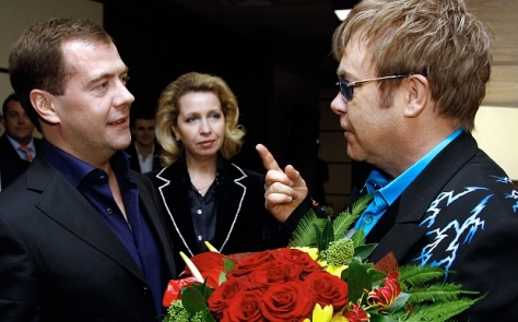 Dmitry Medvedev, Elton John...Russian President Dmitry Medvedev, left, listens to English musician Elton John after his concert in Moscow on Sunday, Dec. 12, 2010. Medvedev's wife Svetlana smiles at center. (AP Photo/RIA Novosti, Dmitry Astakhov, Presidential Press Service)